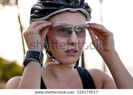 young female wearing protective cycling glasses
