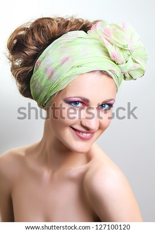 Young Female with exotic hairstyle and bright makeup - stock photo