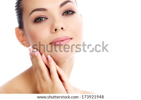 Young female with fresh clear skin, white background  - stock photo