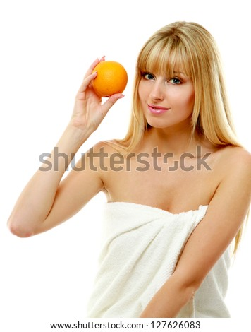 Young female with orange isolated on white