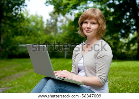 Young female working on a laptop in an outdoor setting