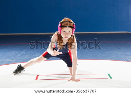 Young female wrestler in her stance