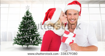 Young festive couple against home with christmas tree - stock photo