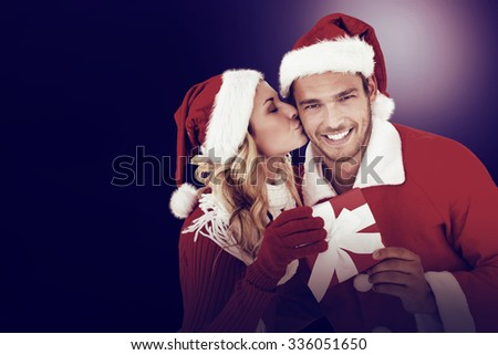 Young festive couple on dark background - stock photo