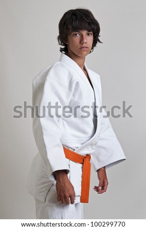 Young fighter posing isolated against a light background - stock photo