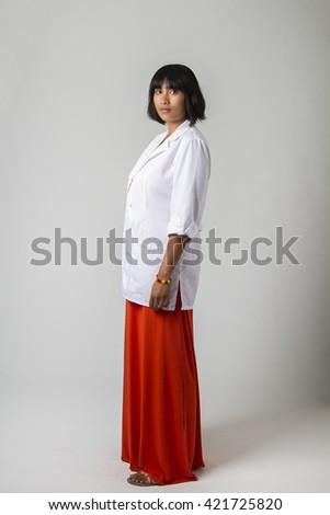 Young filipino woman wearing a lab coat - stock photo
