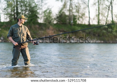 Young fisherman fishing in the river