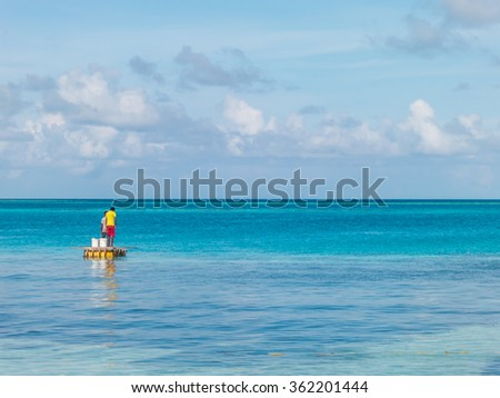 Young fishermen with clear blue sea and sky