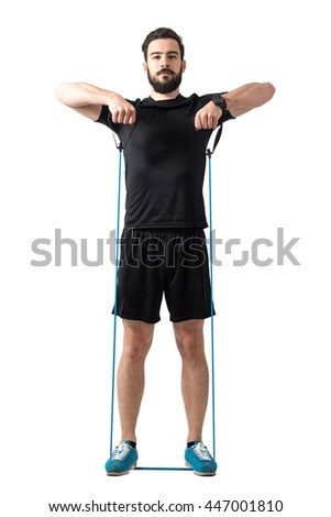 Young fit athletic man shoulder exercising with resistance bands. Full body length portrait isolated over white studio background. - stock photo
