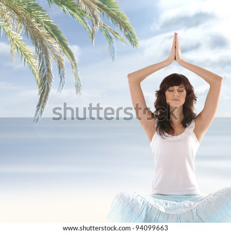 Young fit brunette meditating on white - stock photo
