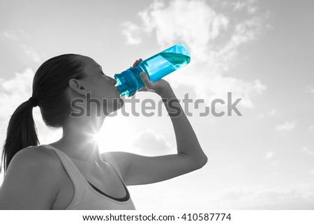 Young fit female enjoying a bottle of water.  - stock photo