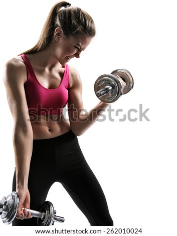 Young fit girl going in for sport with dumbbells / photo set of sporty muscular female brunette girl wearing sports clothes working out with dumbbells over white background