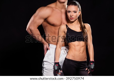 Young fit woman and bodybuilder. Couple of fitness models. Modern art of bodybuilding. Trainer and his student. - stock photo