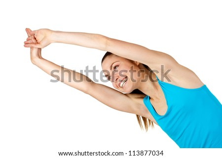 Young fit woman doing push ups.Isolated on white background.