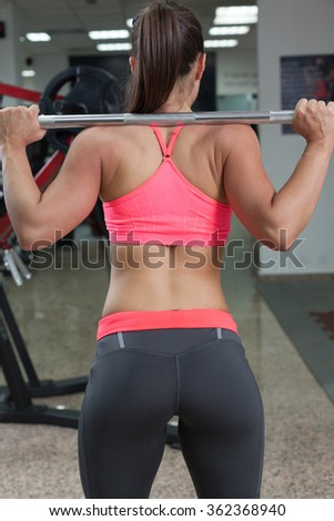 Young fit woman doing squats - stock photo