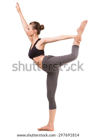 Young fit woman doing yoga exercise on white background. Side view. - stock photo