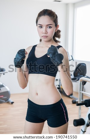 young fit woman exercise in fitness room - stock photo