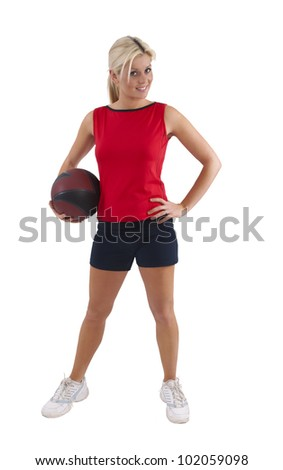 Young fit woman holding a weighted ball