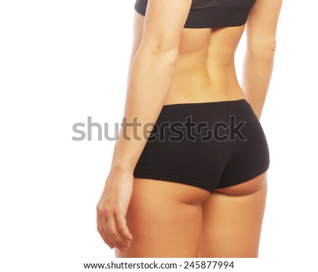 Young fit woman in sports outfit, isolated on white - stock photo