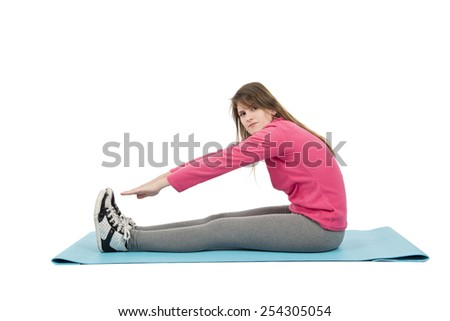 Young fit woman stretching on her mat against a white background - stock photo
