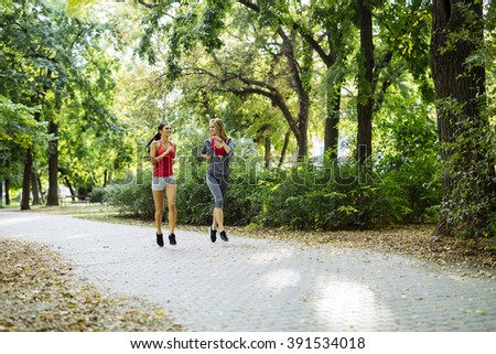 Young fit women jogging outdoors and staying fit - stock photo