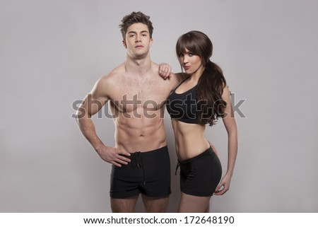Young fitness couple in the studio