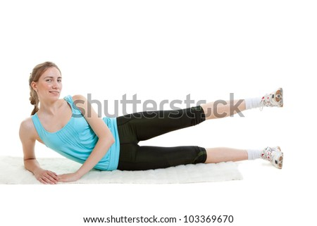 Young fitness girl exercising - stock photo