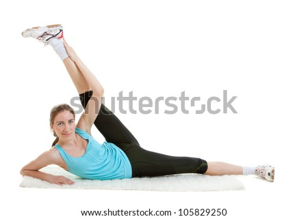 Young fitness girl exercising in the gym - stock photo