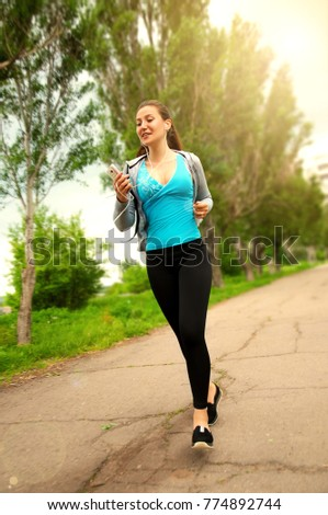Young Fitness Girl Runner Street in the Morning
