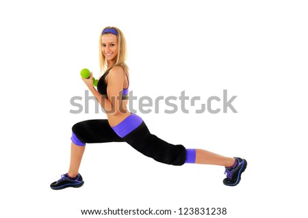 Young fitness instructor against white background standing - stock photo