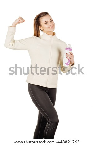 young fitness instructor wearing sportswear  with bottle show her biceps muscles. isolated on white background. fitness, sport and health concept.