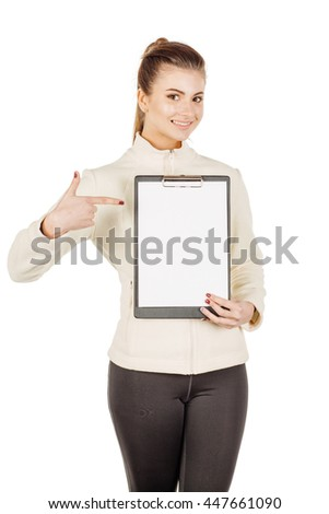 young fitness instructor wearing sportswear with clipboard. isolated on white background. fitness, sport and health concept.
