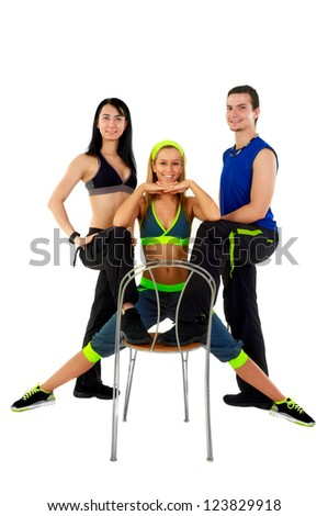 Young fitness instructors against white background standing - stock photo
