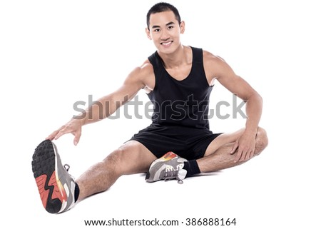 Young fitness man sitting and making stretching exercises - stock photo