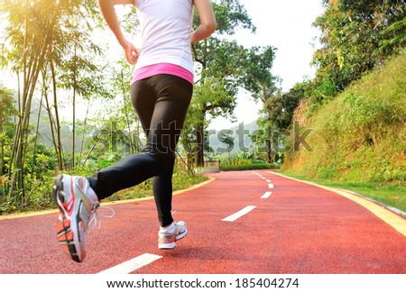 young fitness woman cross country running on mountain trail - stock photo