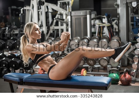 young fitness woman execute exercise in gym,  horizontal photo - stock photo