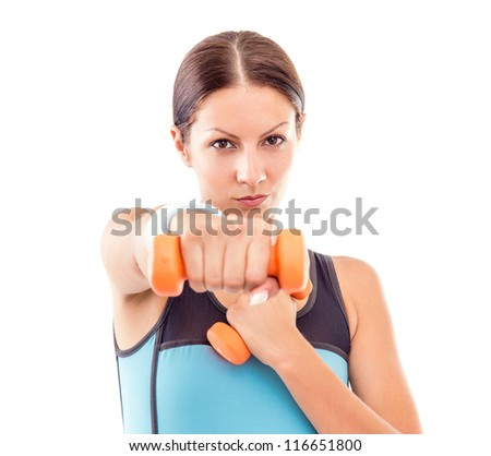 Young fitness woman exercising with small dumbell-FOCUS ON FACE - stock photo