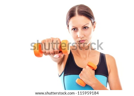 Young fitness woman exercising with small dumbell-FOCUS ON HAND - stock photo