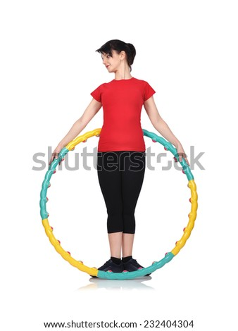 Young fitness woman holding color hula hoop - stock photo