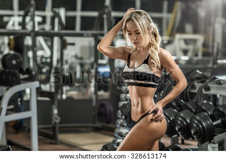 young fitness woman in gym, horizontal photo - stock photo