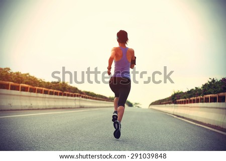 young fitness woman runner running on city road,vintage effect - stock photo