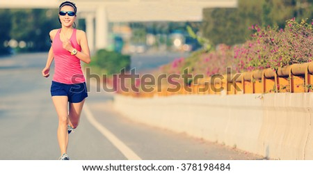 young fitness woman runner running on road - stock photo