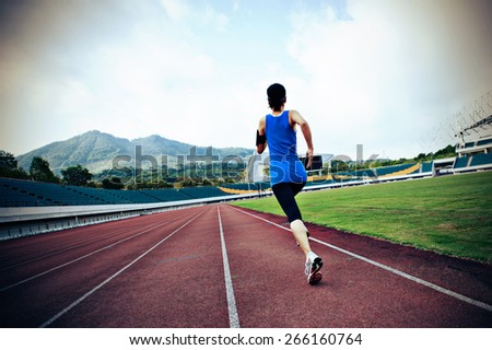 young fitness woman runner  running on track - stock photo