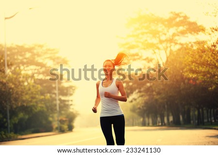 young fitness woman runner running outdoor - stock photo
