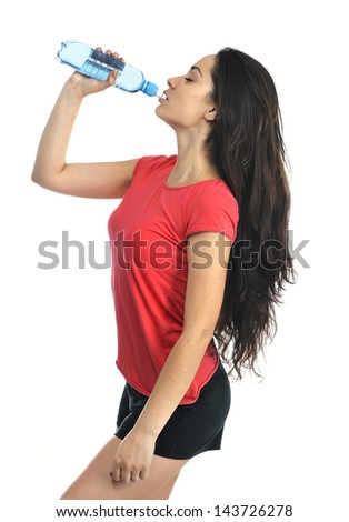Young fitness woman with a bottle of water
