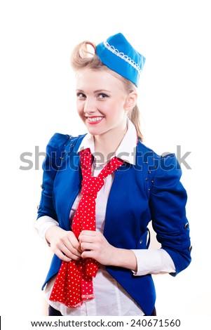 young flight attendant blond pinup woman with curlers in blue jacket & cap, red scarf happy smiling & looking at camera isolated on white background portrait - stock photo