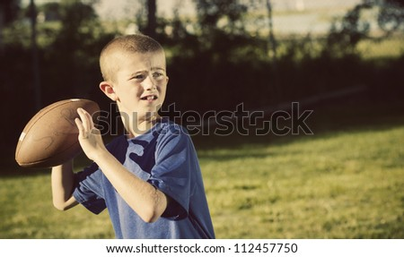 Young Football Player quarterback Vintage theme - stock photo