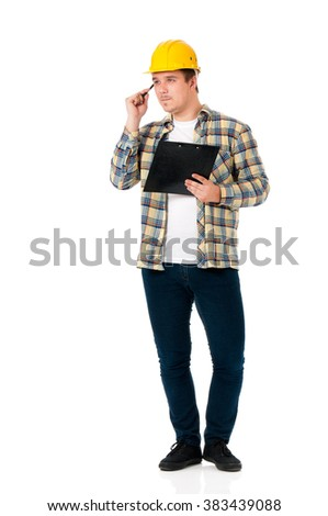 Young foreman with hard hat holding a clipboard, isolated on white background  - stock photo