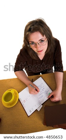 Young freckled woman with yellow cup and eyeglasses