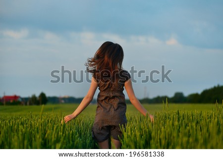 young free woman at spring  running in meadow flowers